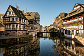 Traditional half-timbered houses on the canal in La Petite France district in sunny autumn, Strasbourg, Alsace-Champagne-Ardenne-Lorraine, France, Europe
