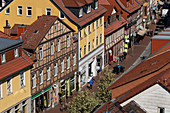 View from above of the half-timbered houses of the Kurz-Geismar-Strasse, animated with people, G? Ttingen, Lower Saxony, Germany, Europe