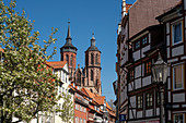 View from the half-timbered town to the St. Johannis church with two towers in spring, St. Johannis church, G? Ttingen, Lower Saxony, Germany, Europe