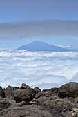 Tanzania, East Africa, Mount Meru in the sea of clouds, view from Kilimanjaro to the summit, rocky abyss on the edge of the hiking trail