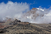 Kilimanjaro, East Africa, view of the summit, third stage, between Shira Camp and Barranco Camp, rising fog, inhospitable landscape without vegetation, lava rock
