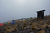 Kilimanjaro, ascent on the Machame route, fourth stage, Karanga Camp, bad weather in the late afternoon, toilet house