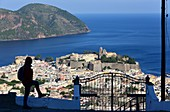by the sea, view to the island's capital with its castle, Lipari, Aeolian Islands, southern Italy