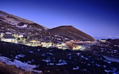 Rifugios, hotels, houses, evening under the Etna volcano, south side, east coast, Sicily, Italy