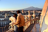 2 people on the church of Santa Agata with a view of Mount Etna, Catania, east coast, Sicily, Italy