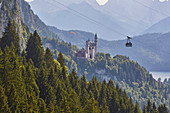 View of Neuschwanstein Castle, Alpsee, paraglider, cable car, Schwangau municipality, Ammer Mountains, Ostallg? U, Bavaria, Germany, Europe