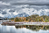 Oxbow Bend with Autumn (Fall) colour and early snow\nGrand Tetons National Park\nWyoming. USA\nLA006577