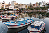 Boats in the lake of Agios Nikolaos - Limni Voulismeni in the evening, Crete, Greece
