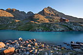 Turquoise Gradensee at the Nossberger Hütte at sunrise in the Gradental in the Hohe Tauern National Park, Austria