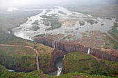 Zambezi River gorge valley, full length of Victoria Falls waterfall and Victoria Falls Bridge, Zimbabwe/Zambia.