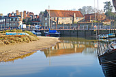 A view of the quayside on the North Norfolk coast at Blakeney, Norfolk, England, United Kingdom.