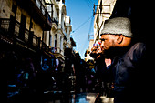 Morocco, Fez - October 6, 2013. A local man is drinking a Coca-Cola at a café in a small street of Fez. (Photo credit: Gonzales Photo - Flemming Bo Jensen).