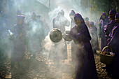 Guatemala, Antigua - March 3, 2013. A street is covered with the smoke of incense during procession for Semana Santa, the Holy Week, in Antigua. (Photo credit: Gonzales Photo - Flemming Bo Jensen).