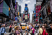New York, United States of America - July 8, 2017. The famous Times Square in Midtown Manhattan at the junction of Broadway and Seventh Avenue in New York City.  The Times Square is one of the world's most visited attractions and one of the busiest pedestrian intersections.