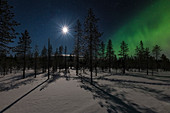 Northern lights and full moon in Finnish Lapland