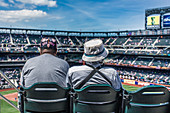 Two New Yorkers at the Mets Stadium in Queens, New York City, USA