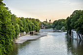 View from the Luitpoltbrücke towards the south down the Isar to the Maximiliansbrücke, the tower of the Muffathalle and the Müller'schen Volksbad, Munich, Bavaria, Germany