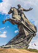 Statue with Cuban flag in the background, Santiago de Cuba, Cuba