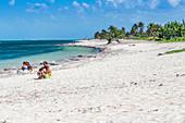 Locals on Playa Santa Lucia beach, Cuba