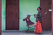 Blind Cuban woman with elderly man enjoy a stress-free afternoon in Ciego de Avila, Cuba