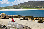 Girl on the beach at Gurteen Bay, Roundstone, County Galway, Ireland