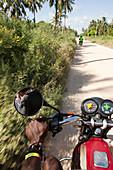 Motorbike taxi through the coconut plantations, Watamu, Malindi, Kenya