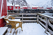 Snow-covered balcony and fishermen's houses, Nusfjord, Lofoten, Nordland, Norway