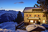 Illuminated Neue Bielefelder Hütte in winter, Ötztal Alps in the background, Neue Bielefelder Hütte, Stubai Alps, Tyrol, Austria