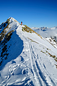 Woman on ski tour climbs to the Wetterkreuzkogel, Wetterkreuzkogel, Stubai Alps, Tyrol, Austria