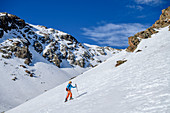 Woman on ski tour climbs to Plereskopf, Plereskopf, Matscher Valley, Ötztal Alps, South Tyrol, Italy