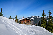 Small alpine hut in winter, Risserkogel, Bavarian Alps, Upper Bavaria, Bavaria, Germany