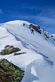 Four people on a ski tour ascend to Pangert, Pangert, Tux Alps, Tyrol, Austria