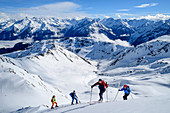 Four people on a ski tour ascend to the Pangert, Zillertal Alps in the background, Pangert, Tux Alps, Tyrol, Austria