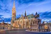 The illuminated Matthias Church during the blue hour in Budapest, Hungary