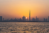 City skyline with the setting sun, Dubai, UAE