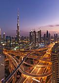 The illuminated city with the Burj Khalifa in Dubai, UAE
