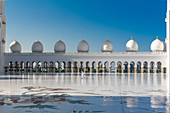 Local people in the courtyard of the Sheikh Zayed Grand Mosque in Abu Dhabi, UAE