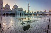 Sunset over the domes of the Sheikh Zayed Grand Mosque in Abu Dhabi, UAE