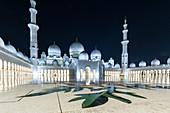 The illuminated Sheikh Zayed Mosque in Abu Dhabi, UAE