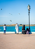 Locals enjoy the afternoon at Breakwater Beach in Abu Dhabi, UAE