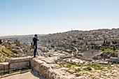 Tourist taking pictures of the city, Amman, Jordan