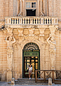 Tourists in front of the museum in Mdina, Malta