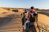 Tourists ride through Erg Chebbi, Morocco