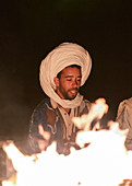 Berber at night around the campfire in Erg Chebbi, Sahara, Morocco