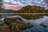 Early morning at Thalersee with pink clouds and beautiful autumn colors, Graz, Austria