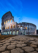 Just before sunrise in front of the remains of the Colosseum in Rome, Italy