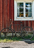 Old bike in front of an old Swedish house in Skansen, Stockholm, Sweden