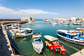 Boats on the breakwater in the port of Heraklion, north Crete, Greece