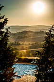 Pool in the evening light, Buonconvento, Tuscany, Italy