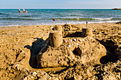 Sand castle with sand toys on sandy beach in Veneto, Italy